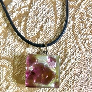 Murano glass pendant and black material necklace.